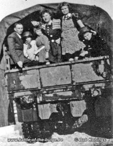 Pol (right with helmet) in a US truck after the war